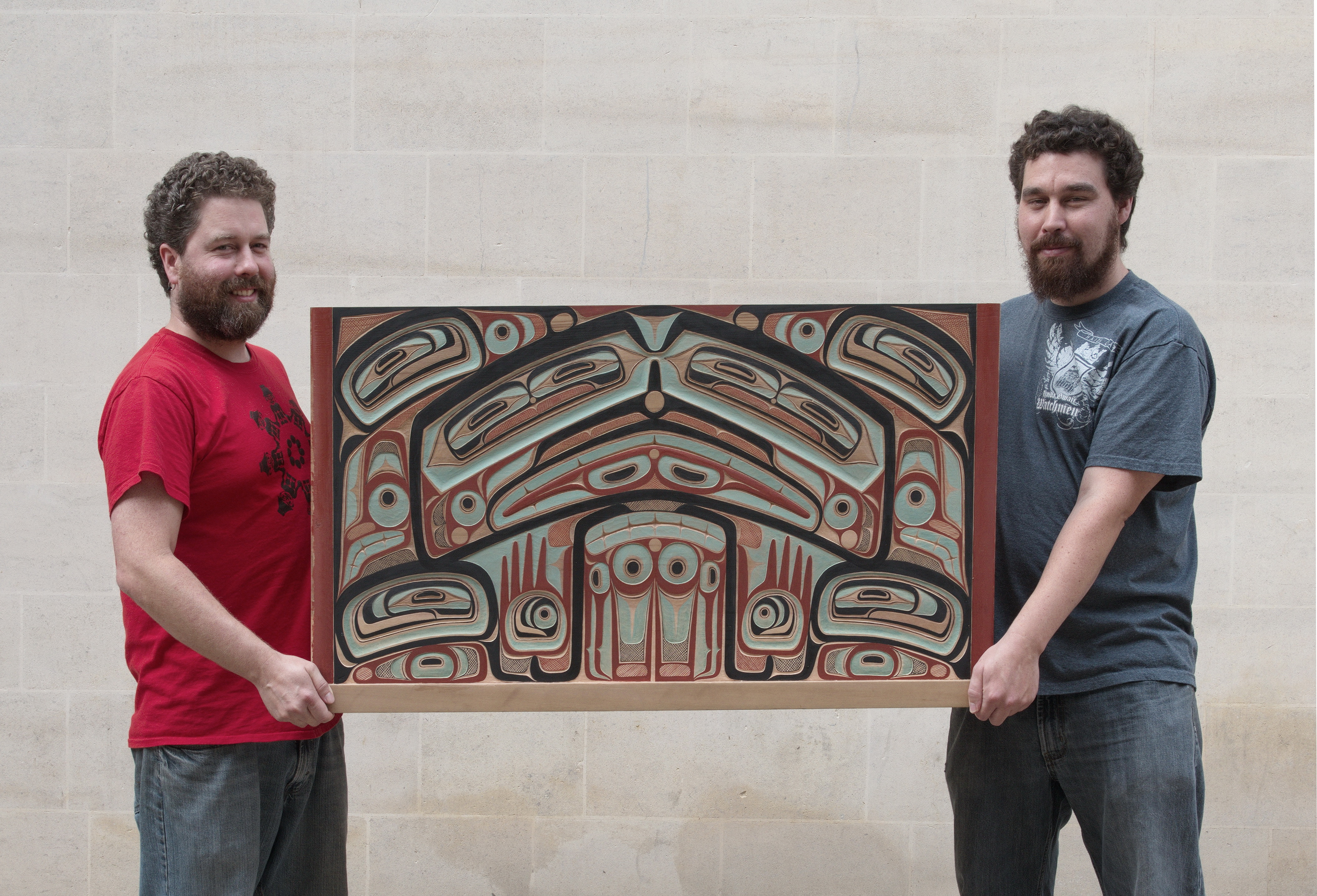 Jaalen and Gwaai holding the replica box bringing it home on October 10th. Photo: Pitt Rivers Museum/Michael Peckett