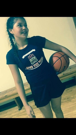 Zoey the Beast Collinson smiles at the Skidegate Saints Jr. Girls practice. Photo: Natasha Collinson.