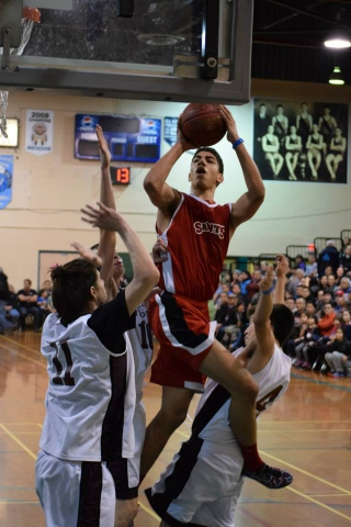 Haida basketball players  perform at the All Native Basketball Tournament. The nation finished the 2015 tournament by taking home one sportsman-like team award, two first places, and two second places. Pictured: Ryan Barnes